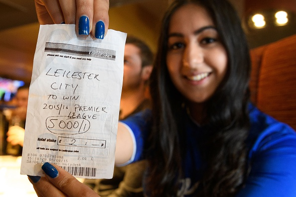 Student Karishma Kapoor holds her betting slip with odds of 5000/1 if Leicester City win the Premiership title, ahead of watching the Leicester City vs Manchester United match in Leicester on 1 May, 2016. Kapoor, aged 20, originally placed a ??2 bet with Ladbrokes and is set to win ??10,000 if her team wins today. / AFP / LEON NEAL (Photo credit should read LEON NEAL/AFP/Getty Images)