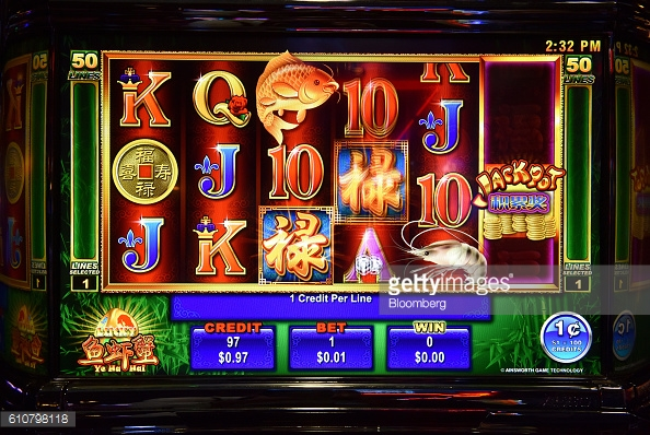 Numbers and symbols are displayed on the screen of a poker machine in the gaming room at the Vikings Club in Canberra, Australia, on Monday, Sept. 26, 2016. Despite having less than half a percent of the world's population, Australia is home to a fifth of the world's slot machines. Photographer: Mark Graham/Bloomberg