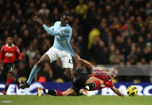 Nemanja Vidic of Manchester United clashes with Yaya Toure of Manchester City