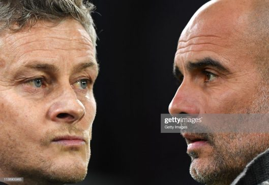 Ole Gunnar Solskjaer, Manager of Manchester United (L) and Josep Guardiola, Manager of Manchester City